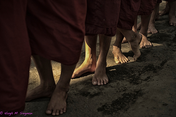 Monks lining up for food at monastery in Mandalay